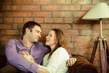 Happy couple sitting on sofa