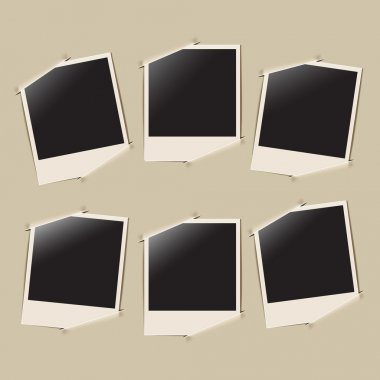 Retro photo frames on album background