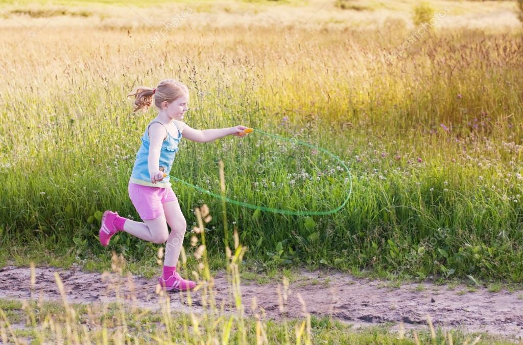 Girl jumping over a skipping rope
