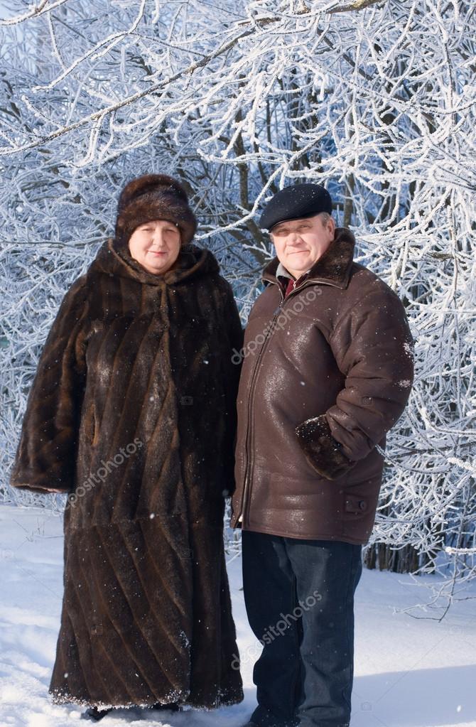 elderly couple in winter park