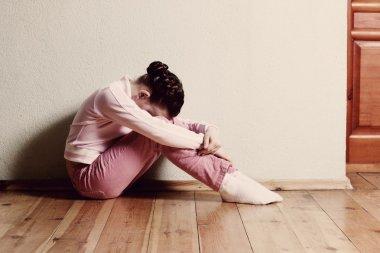 sad girl on floor