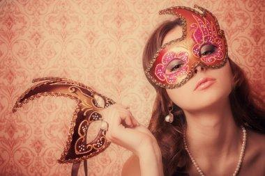Beautiful girl in mask
