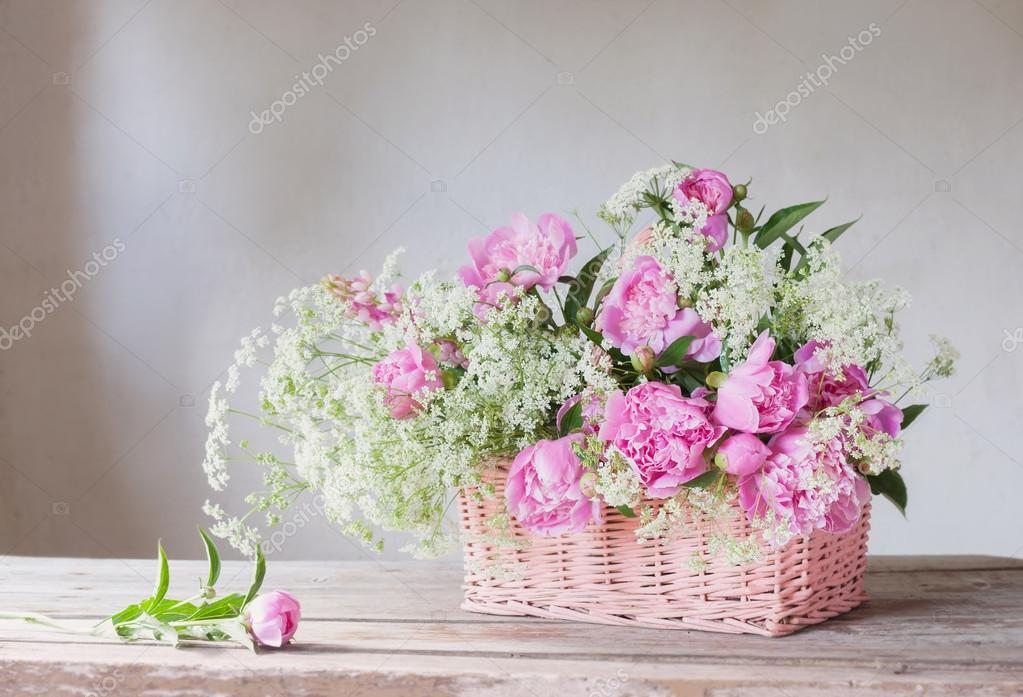 pink peony in basket