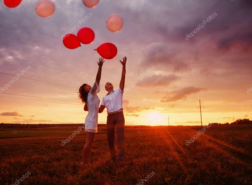 Wedding couple with balloons outdoor