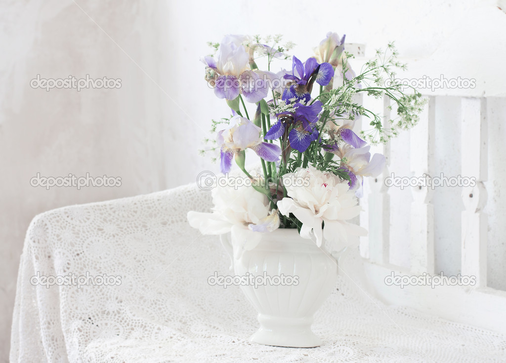 flowers on wooden bench