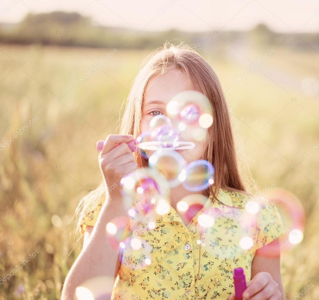 happy girl with soap bubbles