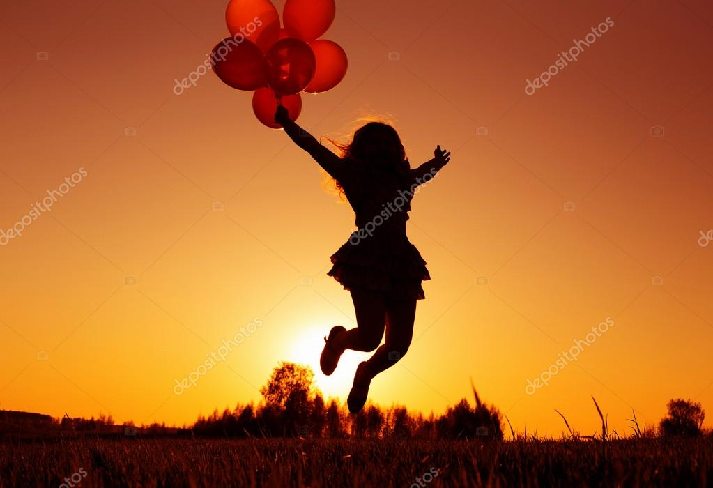 Girl with balloons jumping outdoor