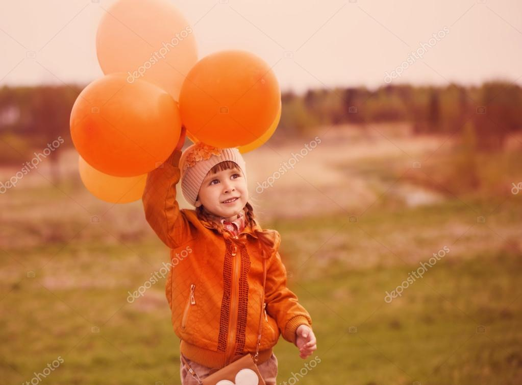 girl with orange balloons