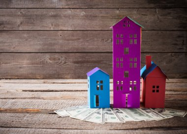Dollars banknotes and houses