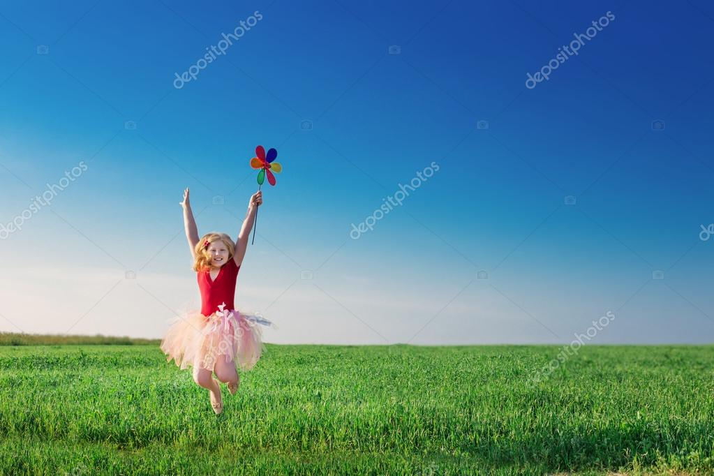 Girl jumping in field