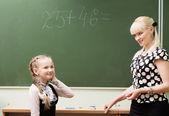Photo Schoolgirls and teacher in the classroom