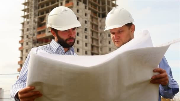 Construction engineers at construction site, handshaking