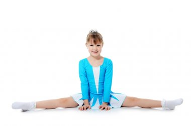 Little girl the gymnast does exercise