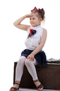 beautiful young female child model sitting on a chest