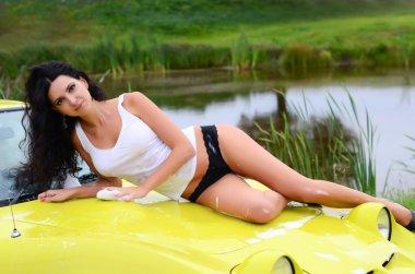 beautiful woman washes  car