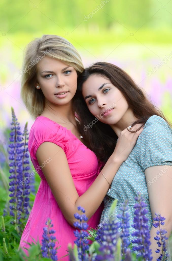 Two beautiful girls in   field
