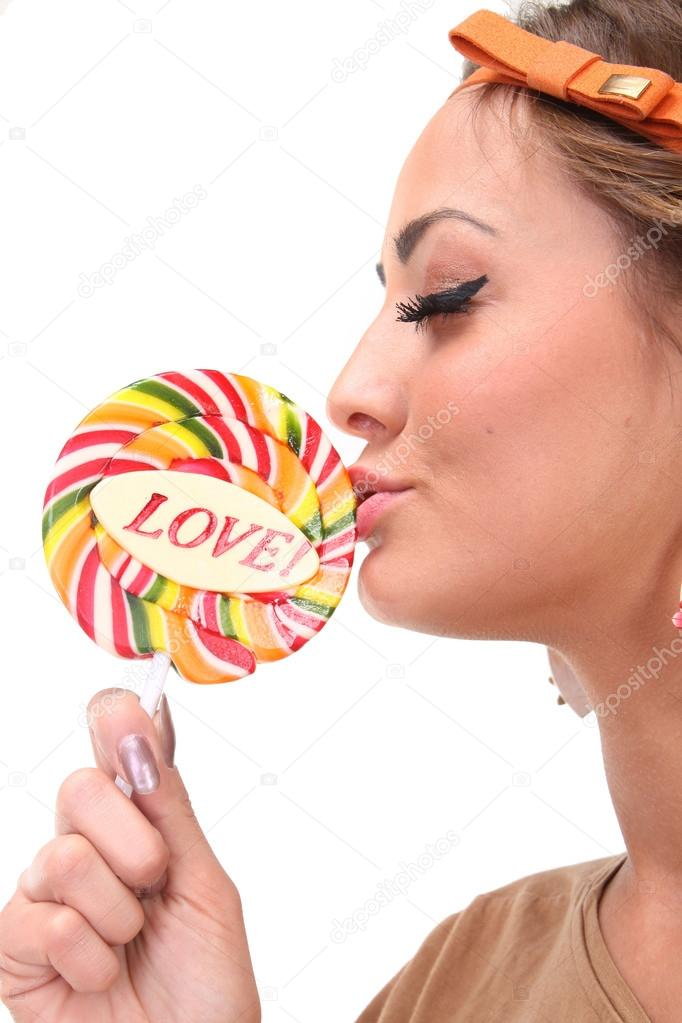 Image of sexy girl kisses a candy