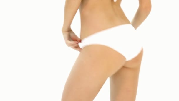 Female buttocks in white panties
