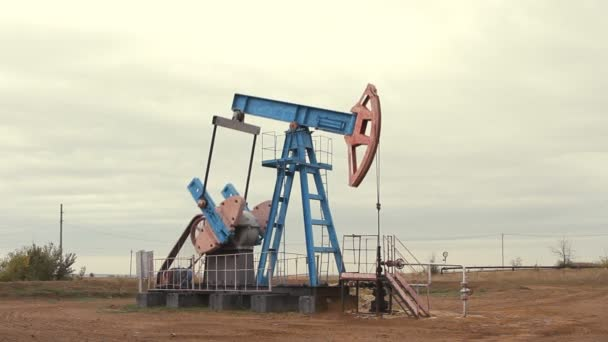 Oil and gas industry. Work of oil pump jack on a oil field