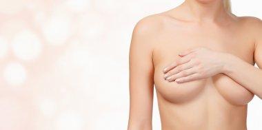 female breast on blurred background