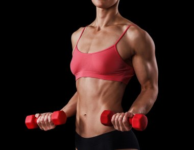 Fitness woman with barbells on black background