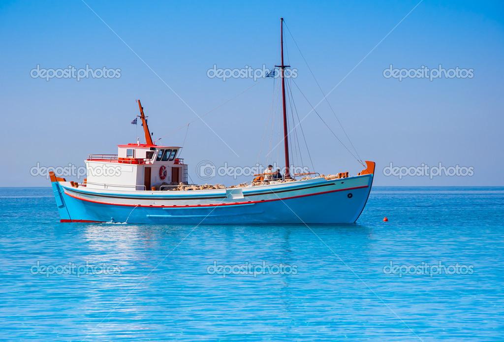 Classical Greek fishing boat in the sea