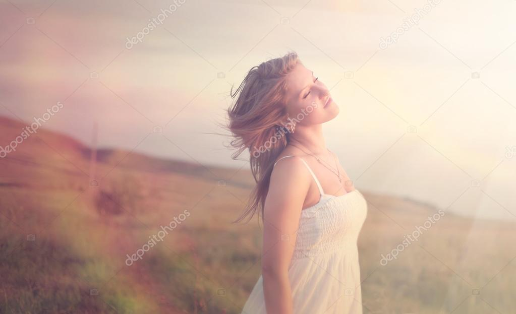 Portrait of a serene woman in the field
