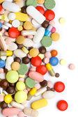 Fotografie barevné prášky, tablety a kapsle