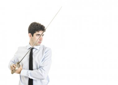 Young Businessman with sword with blank space