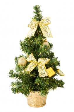 Small christmas tree with gifts, bows and balls on white