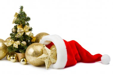 Golden baubles in Santa Claus hat and Christmas tree