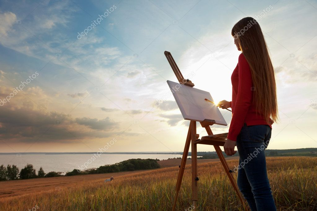 Artist painting an sea landscape