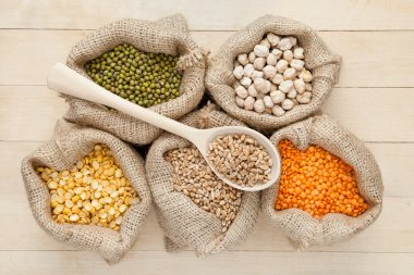 Hessian bags with red lentils, chick peas, wheat and green mug