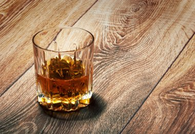 whiskey in glasses on wooden
