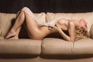 Slim beautiful woman laying on sofa