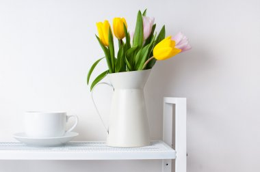 bouquet of tulips and a cup