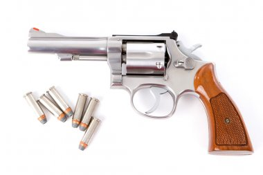 A chrome .38 police special revolver handgun with six hollow point bullets on a white background. stock vector