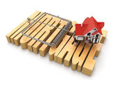 Concept of mortgage. House and mousetrap.
