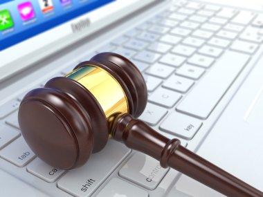 Online judgement. Gavel on laptop. 3d