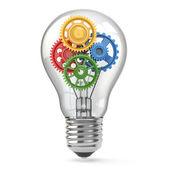 Glühbirne und Getriebe. Perpetuum mobile Idee Konzept