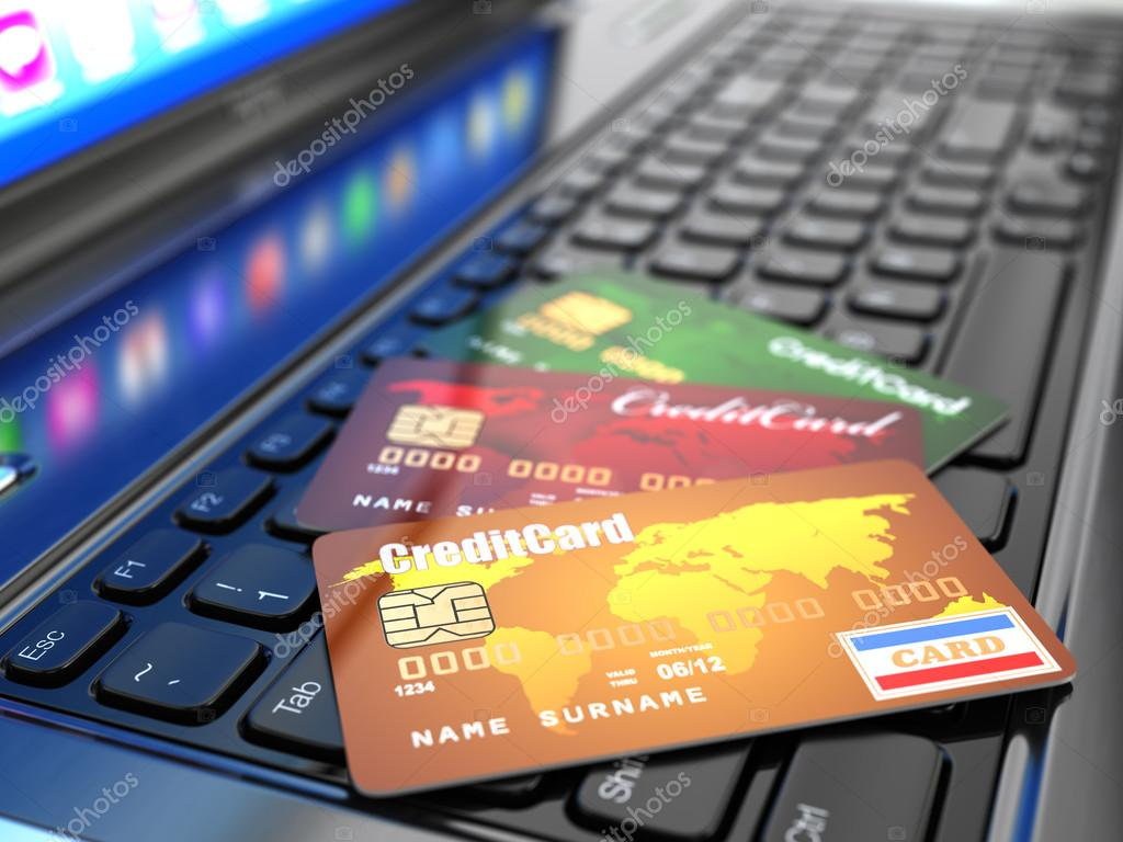 E-commerce. Credit card on laptop keyboard.