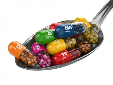 Dietary supplements. Variety pills. Vitamin capsules on the spoo