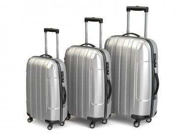 Baggage. Aluminium suitcases on white isolated background.
