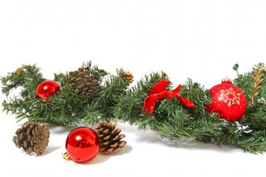 Christmas decorations and pine cones isolated on white backgroun