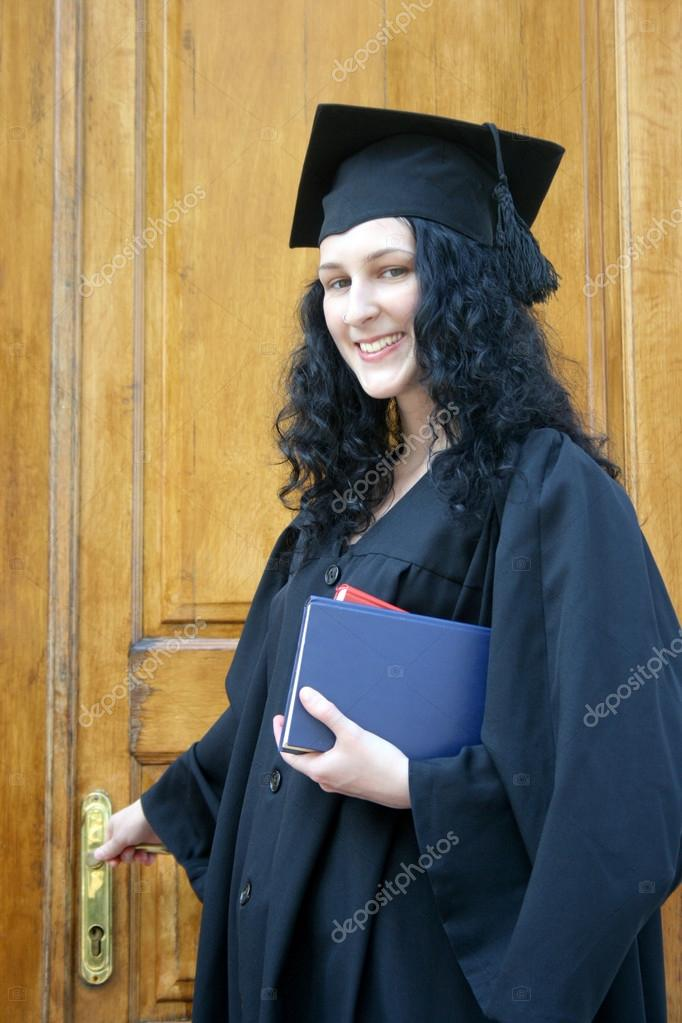 Young laughing student in gown near the university — Stock Photo ...