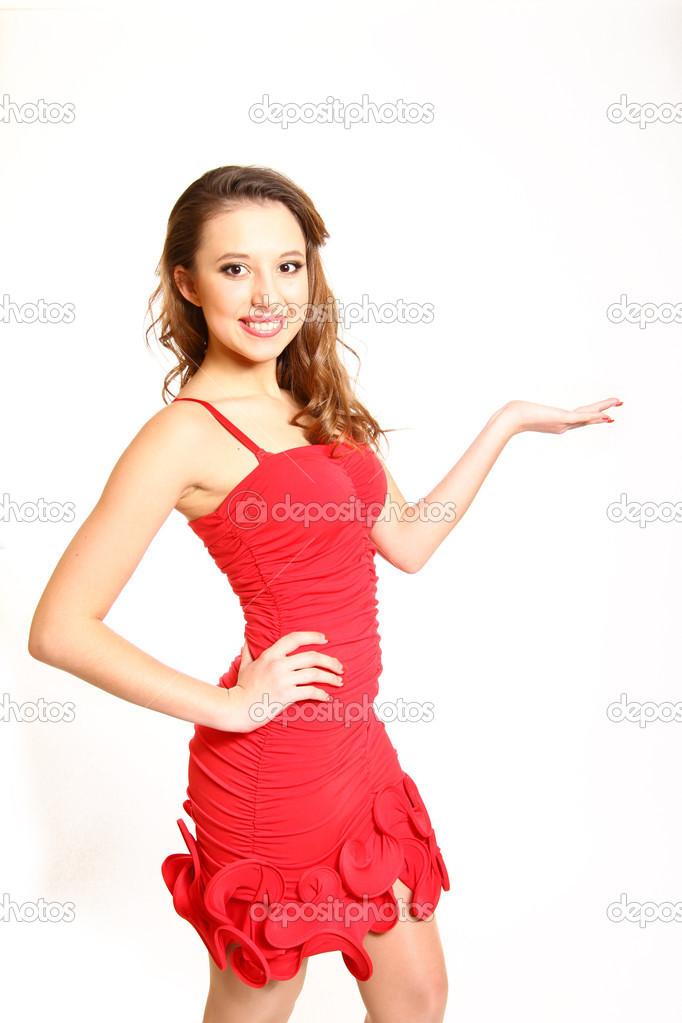 d4a163cc8cd84c Portret van mooi meisje in een rode jurk vasthouden en palm strop — Foto  van ...
