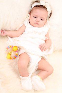Baby girl in white dress