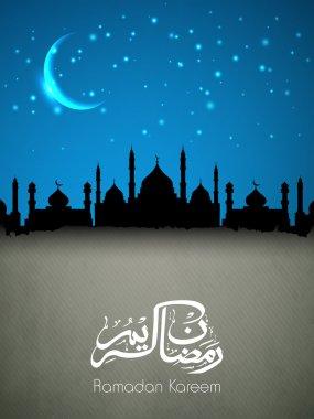 Arabic Islamic calligraphy of text Ramadan Kareem with view of m