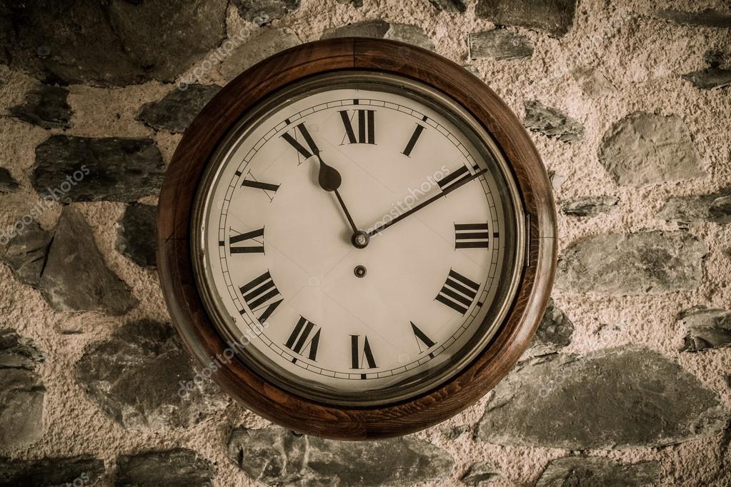 vintage wooden wall clock on stone wall u2014 stock photo