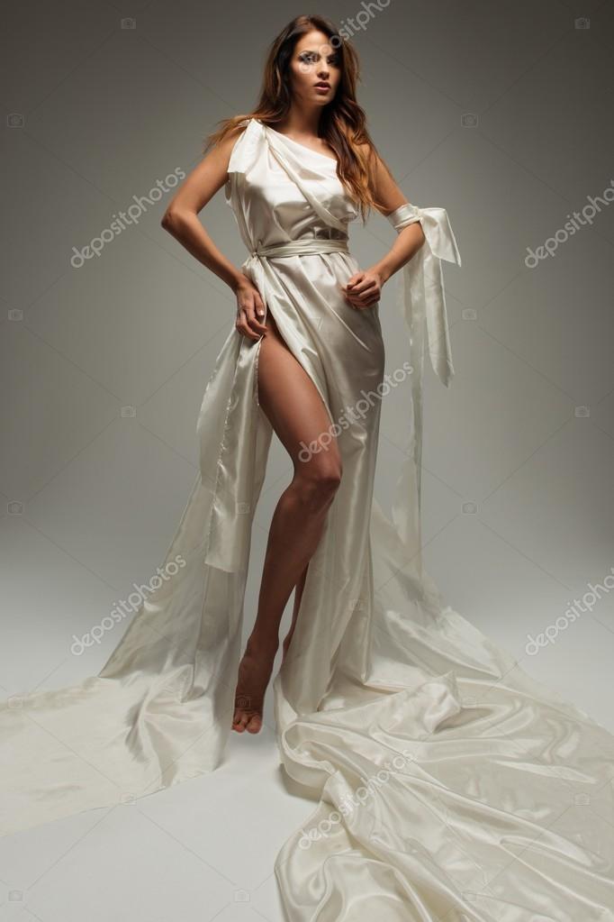 Ancient greek style woman in white tunic — Stock Photo © nejron ...